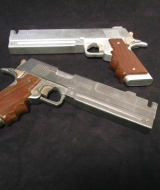 Ebony and Ivory Hand Guns