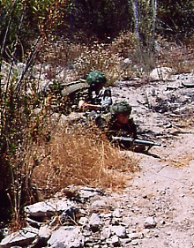 Commonwealth soldiers, crawling under fire.