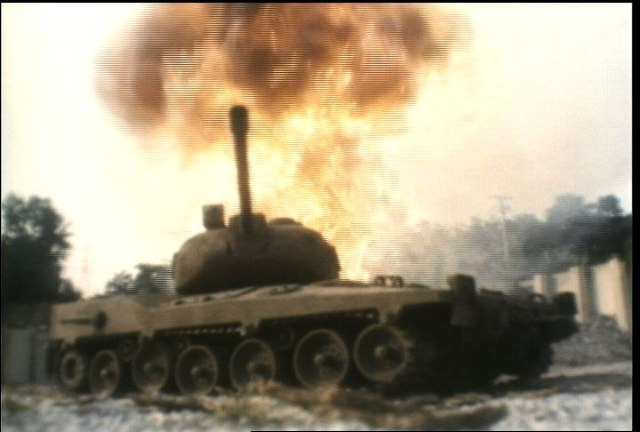 Tank take fir from aerial rockets